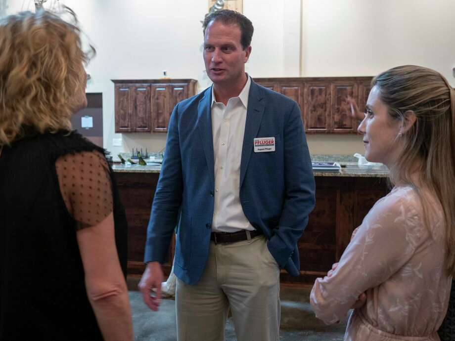 Senate Representative candidate August Pfluger speaks with Ellen Ramsey and Sandra Javelly 10/06/2020 evening during a meet and greet with Midland County Young Republicans at the West Texas Hunting and Fishing Heritage Museum. Tim Fischer/Reporter-Telegram Photo: Tim Fischer, Midland Reporter-Telegram