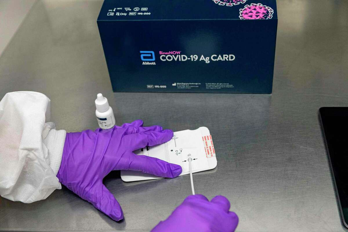 This handout photo obtained September 29, 2020 courtesy of Abbott, shows Abbott's BinaxNOW Covid-19 Ag Card, a rapid, reliable, highly portable, and affordable tool for detecting active coronavirus infections at massive scale. - Abbott announced on August 26, 2020, that the US Food and Drug Administration (FDA) has issued Emergency Use Authorization (EUA) for its BinaxNOW COVID-19 Ag Card rapid test for detection of COVID-19 infection. Abbott will sell this test for USD $5. It is highly portable (about the size of a credit card), affordable and provides results in 15 minutes.
