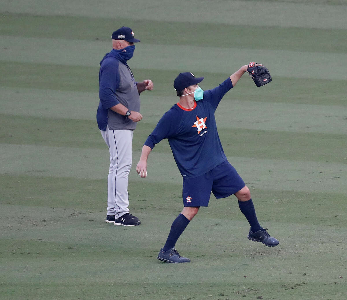 Houston Astros pitching coach Brent Strom works with pitcher Zack Greinke after Game 2 of the American League Division Series on Tuesday at Dodger Stadium in Los Angeles.