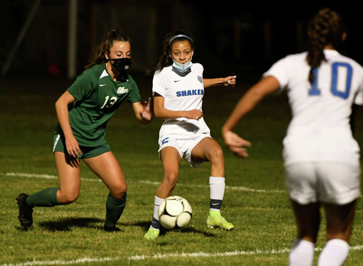 Shen's Sophia Demura looks on as Shaker's Mayah Wheeler passes the ball to a teammate during a game Tuesday, Oct. 6, 2020, in Clifton Park(Jenn March, Special to the Times Union)