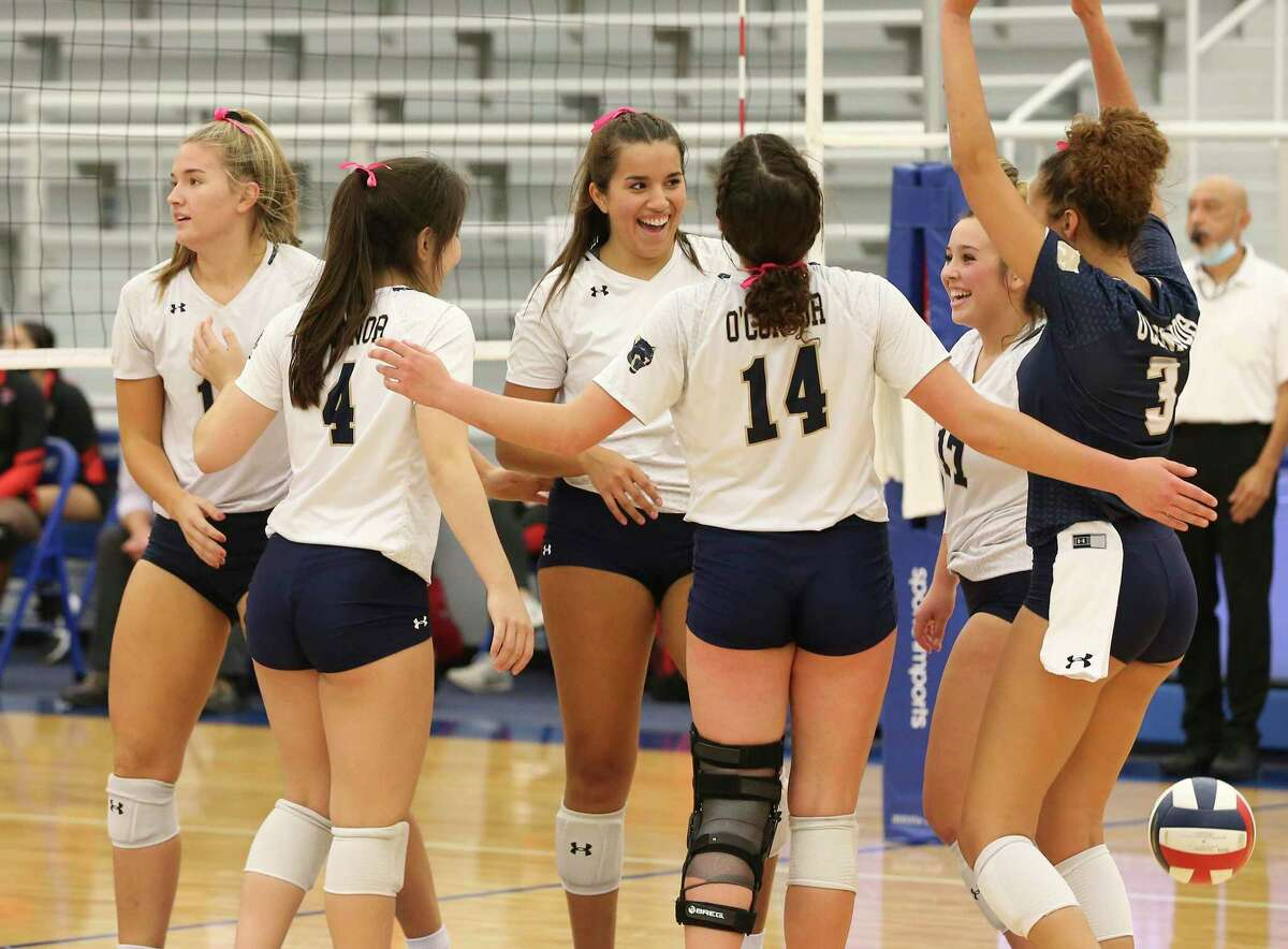 O'Connor players celebrate after a winning point against Stevens during their girls volleyball game at Harlan High School Gymnasium on Tuesday, Oct. 6, 2020. The O'Connor Panthers trounced the Stevens Falcons in three consecutive games to win the contest.