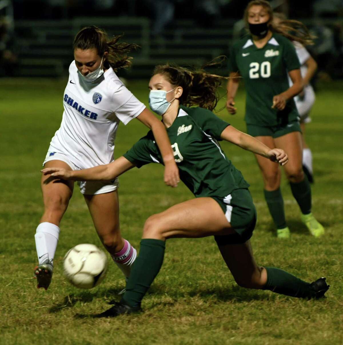 Shen's Mirabel Brunell attempts to block a pass by Shaker's KayLee Alix during a game Tuesday, Oct. 6, 2020, in Clifton Park(Jenn March, Special to the Times Union)