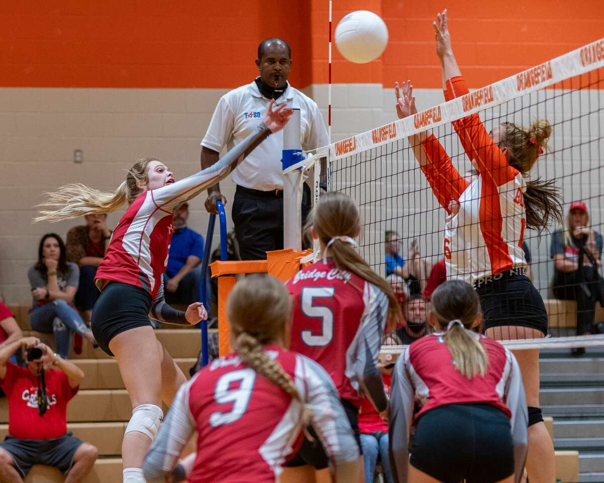 Lady Cardinal Harlee Tupper (3) puts the ball over the net. The Lady Bobcats Volleyball team of Orangefield High School hosted the Lady Cardinals of Bridge City on Tuesday night. Photo made on October 06, 2020. Fran Ruchalski/The Enterprise