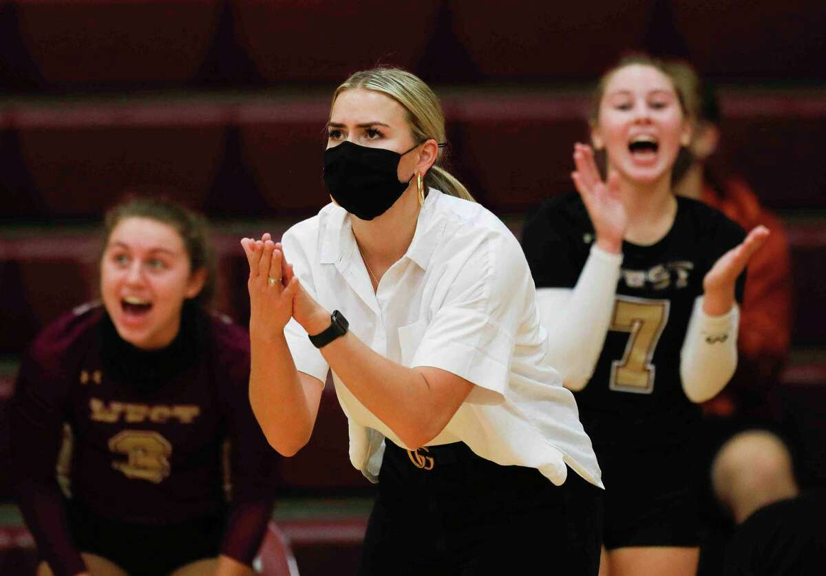Magnoila West head coach Jordan McArdle cheers on players during the third set of a District 19-5A high school volleyball match at Magnolia High School, Tuesday, Oct. 6, 2020, in Magnolia. Magnolia West swept Magnolia 3-0.