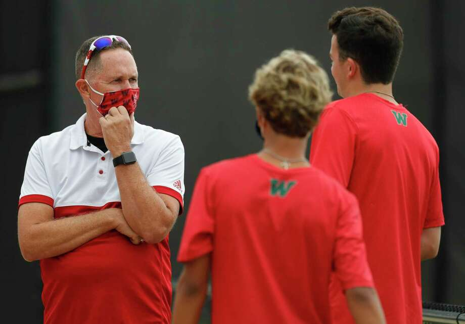 The Woodlands head coach Brett Kendall talks with players before a high school tennis match at Grand Oaks High School, Thursday, Sept. 24, 2020, in Spring. Photo: Jason Fochtman, Houston Chronicle / Staff Photographer / 2020 © Houston Chronicle