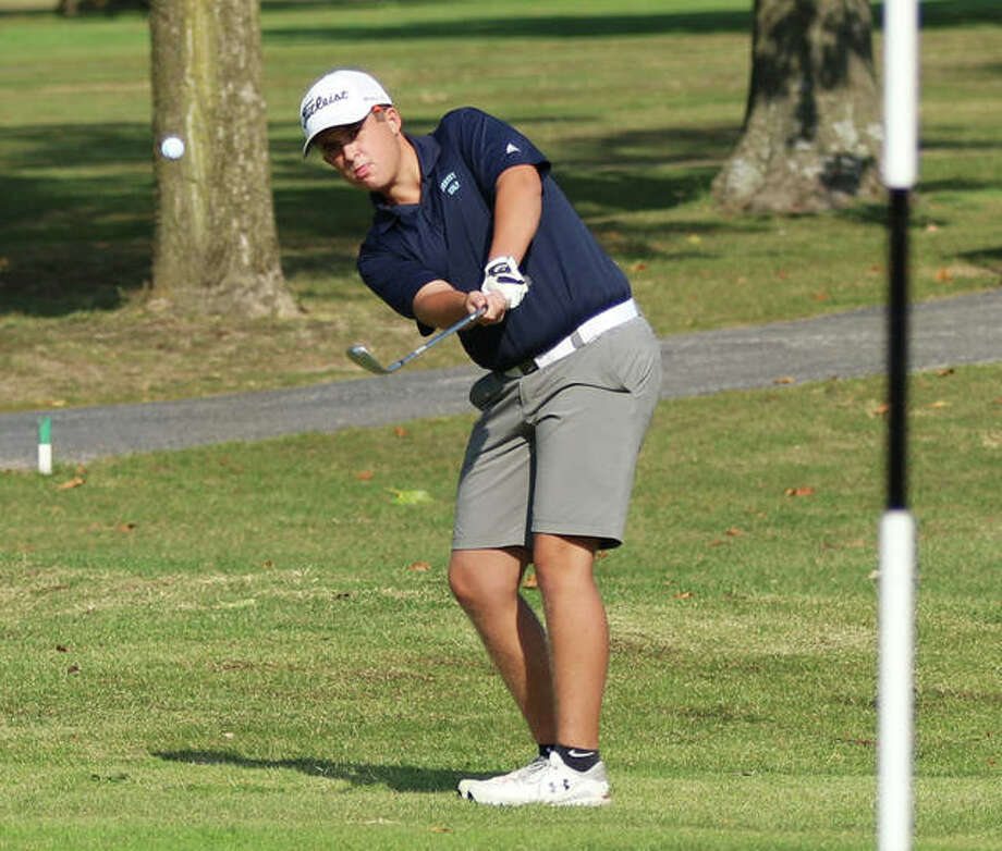 Jersey's Clark Norris chips onto the green on hole No. 1 at Belk Park golf course on Tuesday in the Roxana Class 2A Regional in Wood River. Norris tied for fifth with an 83 and advanced to the sectional. Photo: Greg Shashack / The Telegraph