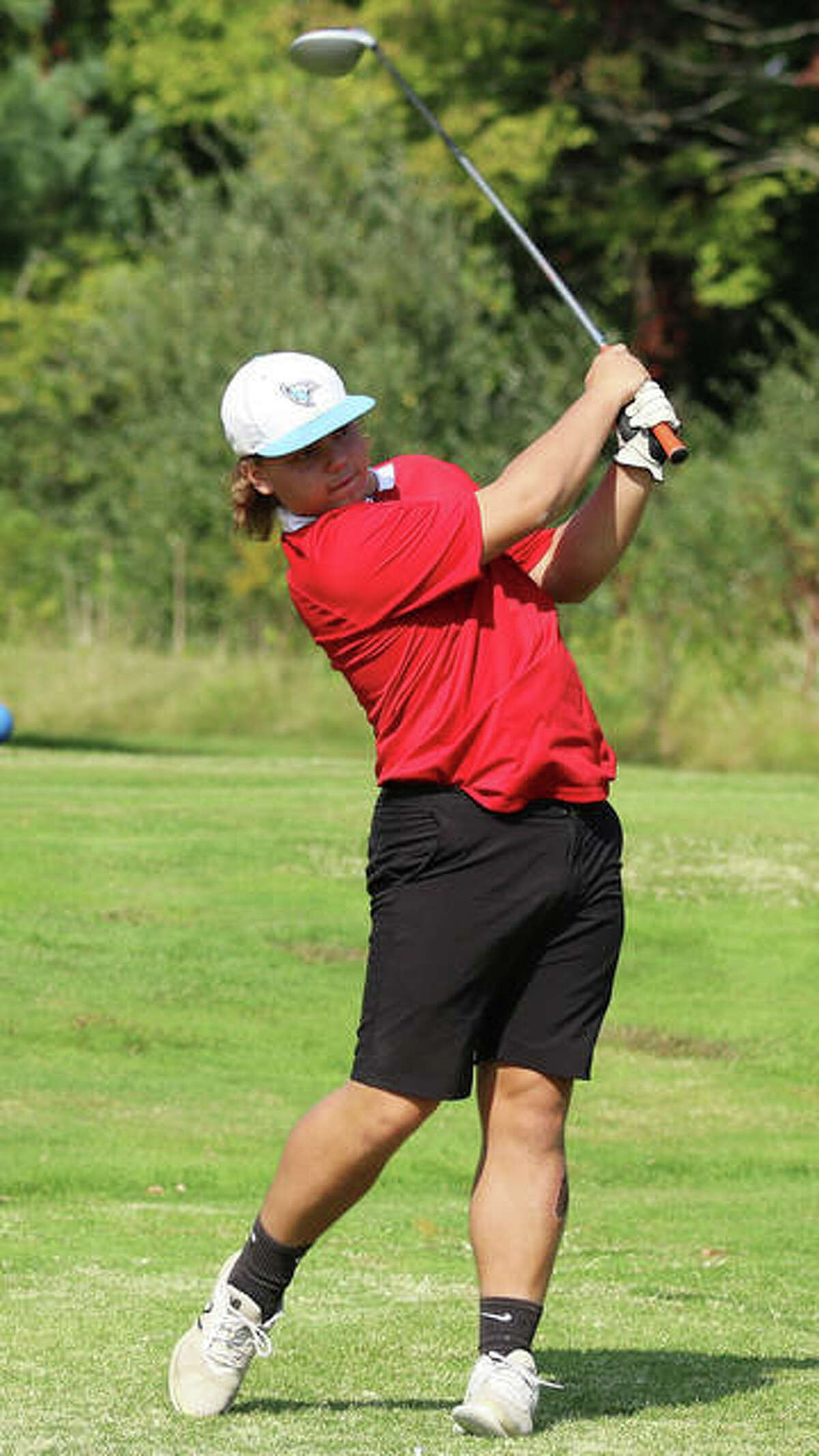 Roxana's Christian Floyd hits a tee shot during the Roxana Class 2A Regional on Tuesday at Belk Park golf course in Wood River. Floyd earned one of four individual berths to the sectional by shooting 85.