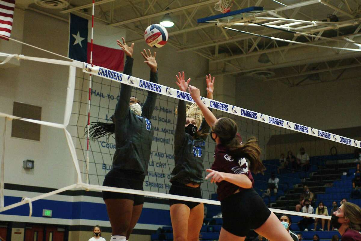 Clear Creek's Brooke Morgan (15) tries to hit over Clear Springs' Alana Dawson (5) and Lizzie Canady (17) Tuesday at Clear Springs High School.