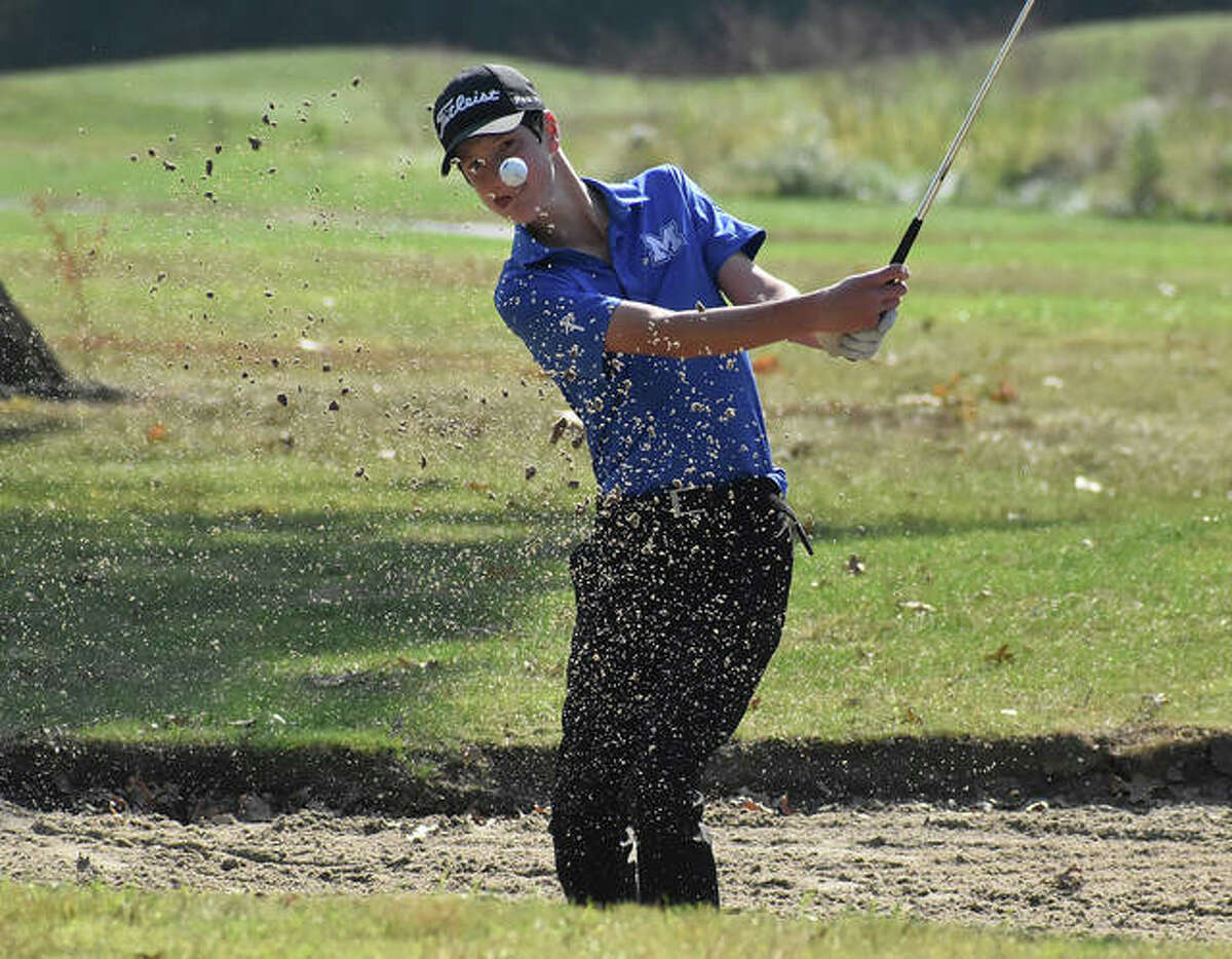 Marquette Catholic's Aidan O'Keefe hits out of the sand during the Staunton Class 1A Regional on Tuesday at Timber Lakes golf course. O'Keefe shot 79 to place sixth.