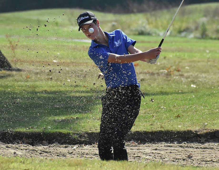 Marquette Catholic's Aidan O'Keefe hits out of the sand during the Staunton Class 1A Regional on Tuesday at Timber Lakes golf course. O'Keefe shot 79 to place sixth. Photo: Matt Kamp / Hearst Illinois