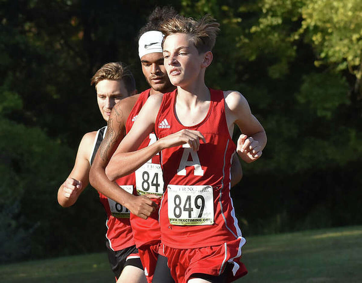 Alton's Parker Mayhew (right) runs with teammate Trae Corby in the Madison County large-schools meet on Wednesday at Moore Park in Alton.