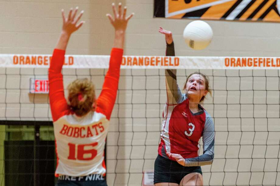 Lady Bobcat Destinie Jeanne (16) tries to defend the shot of Lady Cardinal Harlee Tupper (3). The Lady Bobcats Volleyball team of Orangefield High School hosted the Lady Cardinals of Bridge City on Tuesday night. Photo made on October 06, 2020. Fran Ruchalski/The Enterprise Photo: Fran Ruchalski, The Enterprise / © 2020 The Beaumont Enterprise
