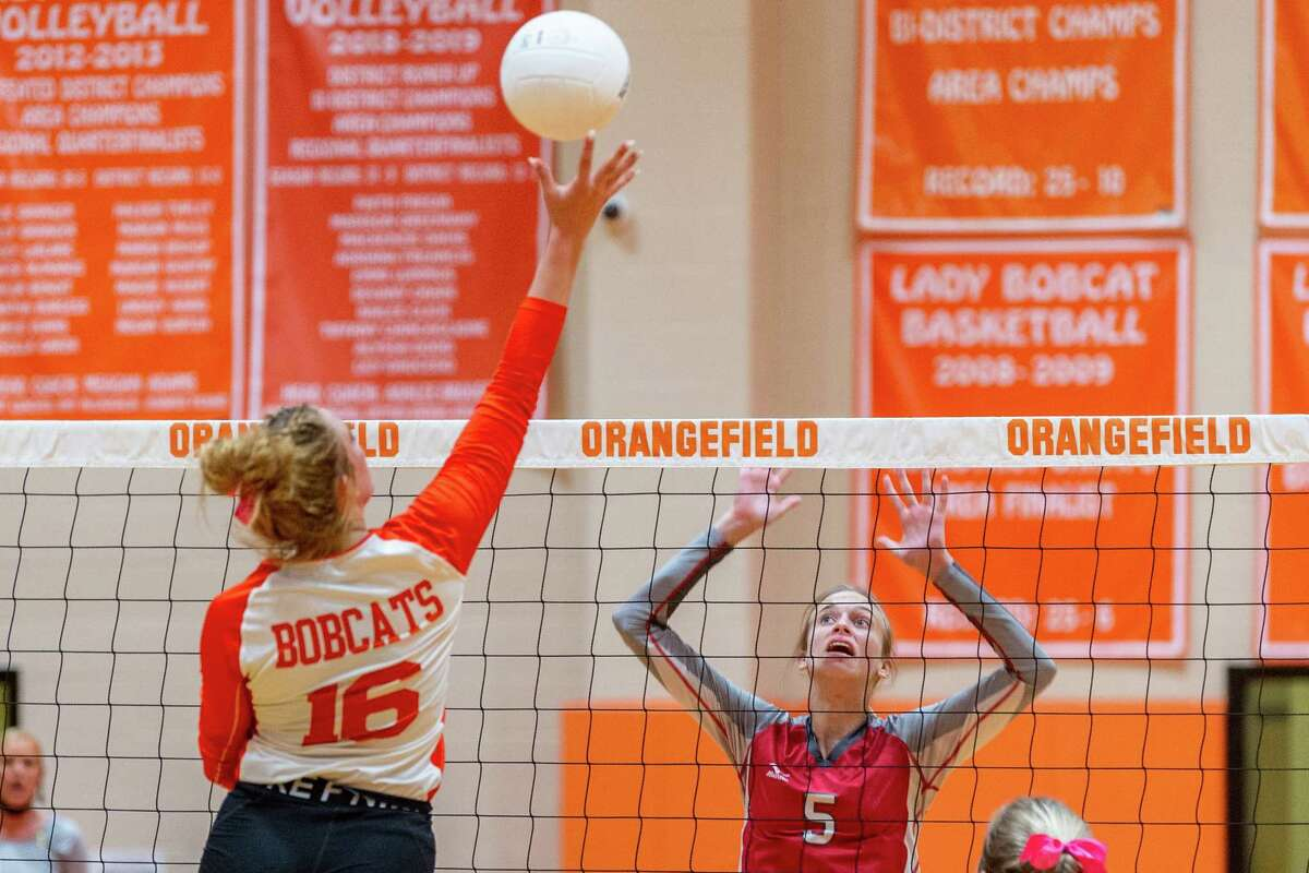 Lady Bobcat Destinie Jeanne (16) puts the ball over the net, out of the reach of Lady Cardinal Demi Carter (5). The Lady Bobcats Volleyball team of Orangefield High School hosted the Lady Cardinals of Bridge City on Tuesday night. Photo made on October 06, 2020. Fran Ruchalski/The Enterprise