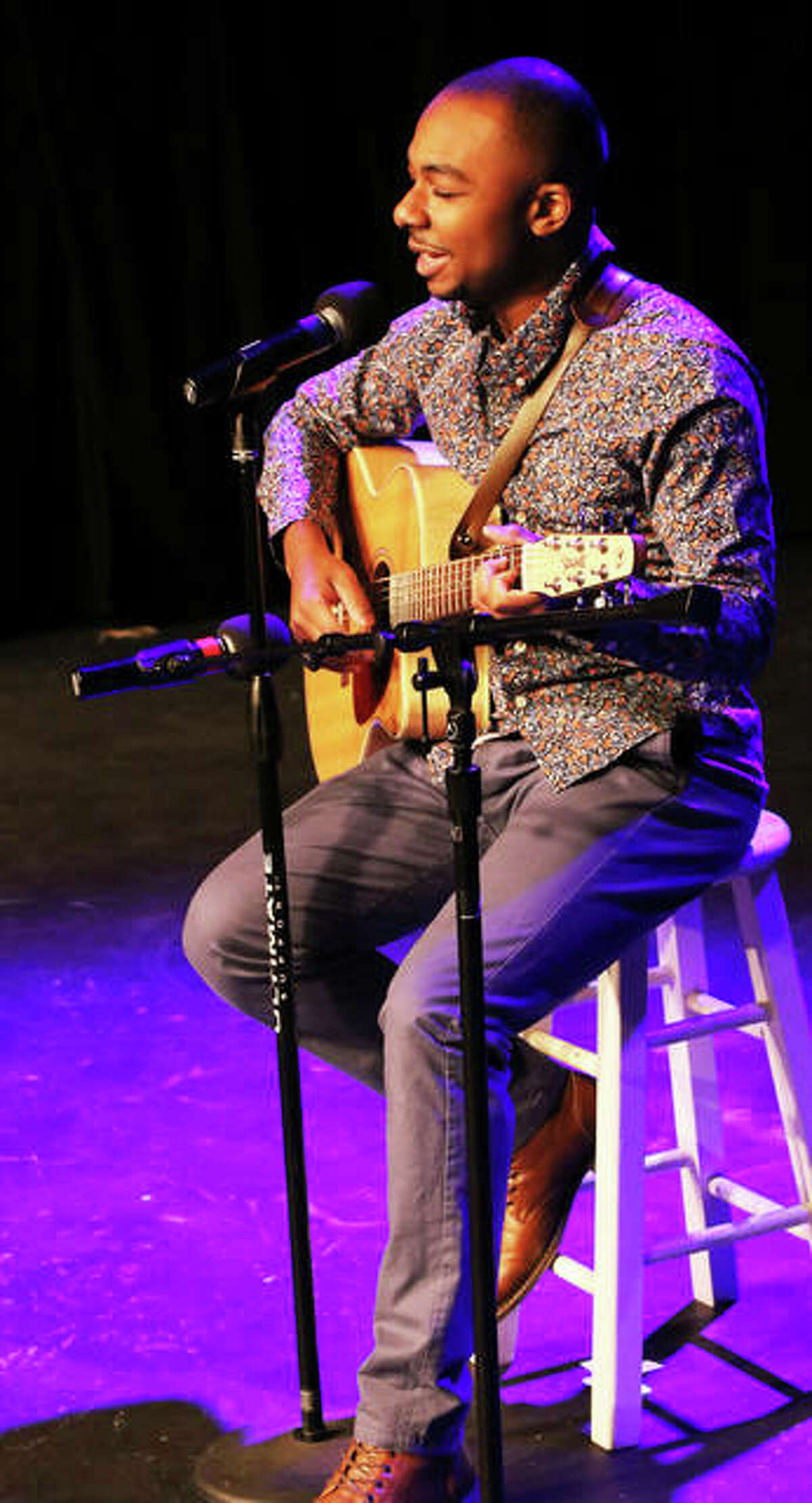 """Miles Brenton, 20, on stage at Alton Little Theater (ALT) Showplace, on Henry Street in Alton, took home first prize in ALT's """"The Riverbend's Got Talent,"""" its first big talent contest. Brenton won with his original song, charm and magical guitar, ALT Executive Director Lee Cox said."""