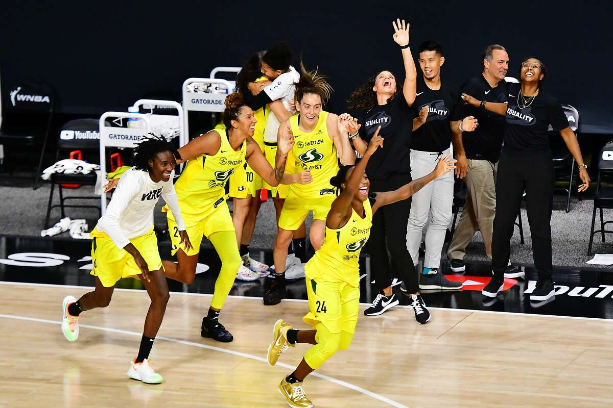 PALMETTO, FLORIDA - OCTOBER 06: The Seattle Storm celebrates their victory in Game 3 of the WNBA Finals against the Las Vegas Aces at Feld Entertainment Center on October 06, 2020 in Palmetto, Florida. NOTE TO USER: User expressly acknowledges and agrees that, by downloading and or using this photograph, User is consenting to the terms and conditions of the Getty Images License Agreement. (Photo by Julio Aguilar/Getty Images)