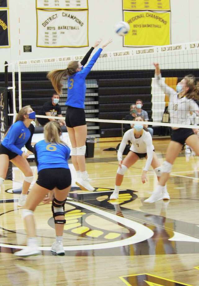 Onekama junior Mairin McCarthy gets a block at the net Tuesday. (Courtesy photo)