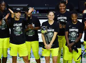 Sue Bird of the Seattle Storm holds on to the WNBA Championship Trophy after defeating the Las Vegas Aces, 92-59, in Game 3 of the WNBA Finals against the Las Vegas Aces at Feld Entertainment Center in Palmetto, Florida, on Tuesday, Oct. 6, 2020. (Julio Aguilar/Getty Images/TNS)