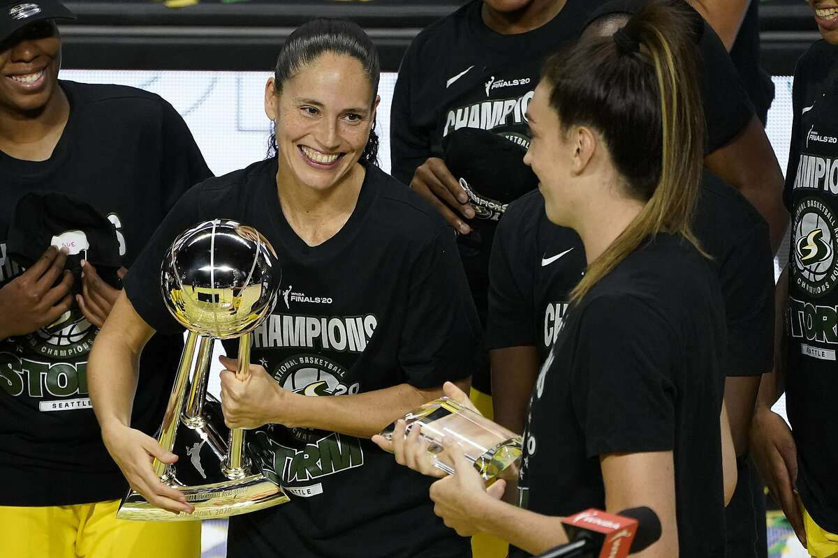 Sue Bird (left) looks at Breanna Stewart, who scored a game-high 26 points to help Seattle clinch its fourth WNBA title. Bird was part of every title-winning team dating back to 2004.