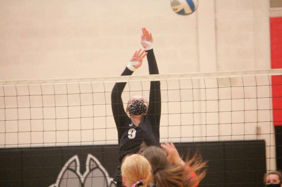 Christina Malackanich goes up for the ball for Reed City in recent action. (Herald Review photo/John Raffel)