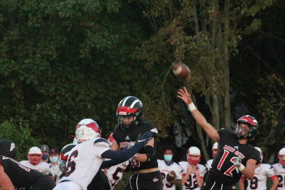 Reed City's Xavier Allen (12) throws a pass in action earlier this season. (Herald Review photo/John Raffel)