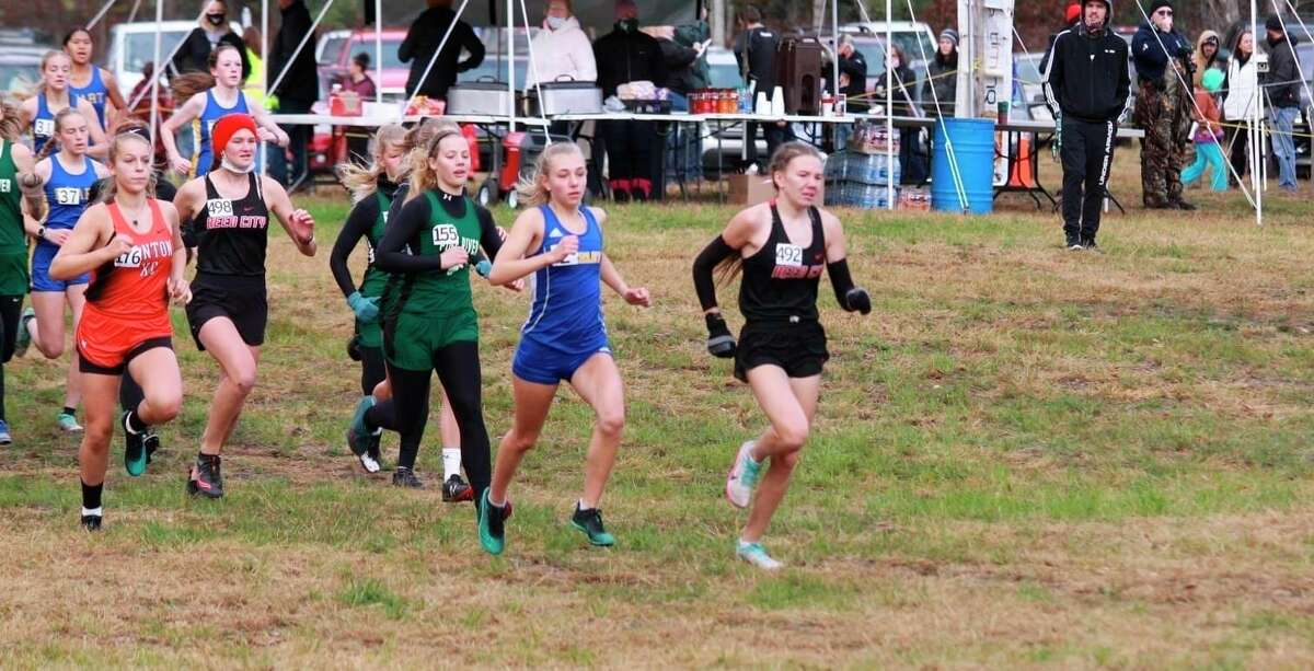 Reed City's Abbigail Kiaunis (right right) leads the pack at the Cecil Burch Invitational on Saturday. (Courtesy photo)
