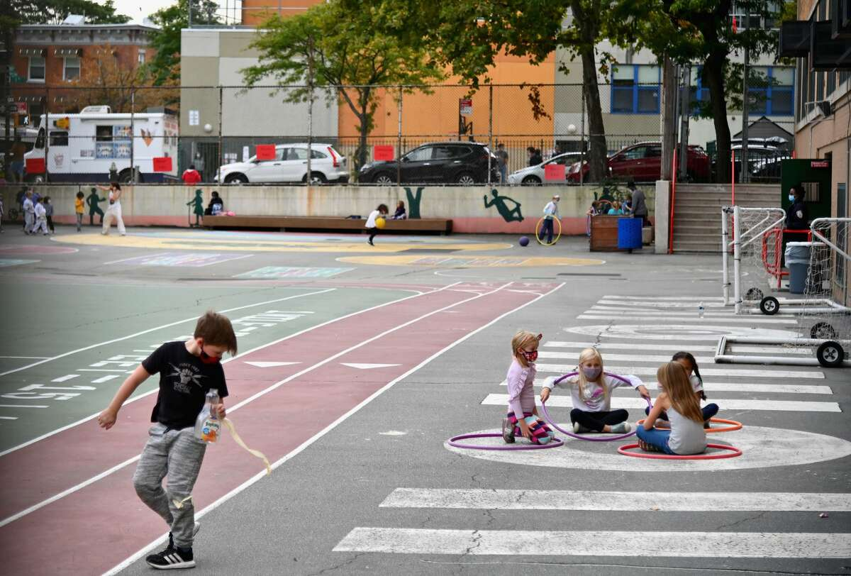 Students play during an after school program at a public school on October 5, 2020 in the Brooklyn Borough of New York City. - New York City Mayor Bill de Blasio said over the weekend he planned to reimpose restrictions on nine neighborhoods as Covid-19 cases rise in parts of the city, which had largely controlled the virus after a catastrophic outbreak. (Photo by Angela Weiss / AFP) (Photo by ANGELA WEISS/AFP via Getty Images)