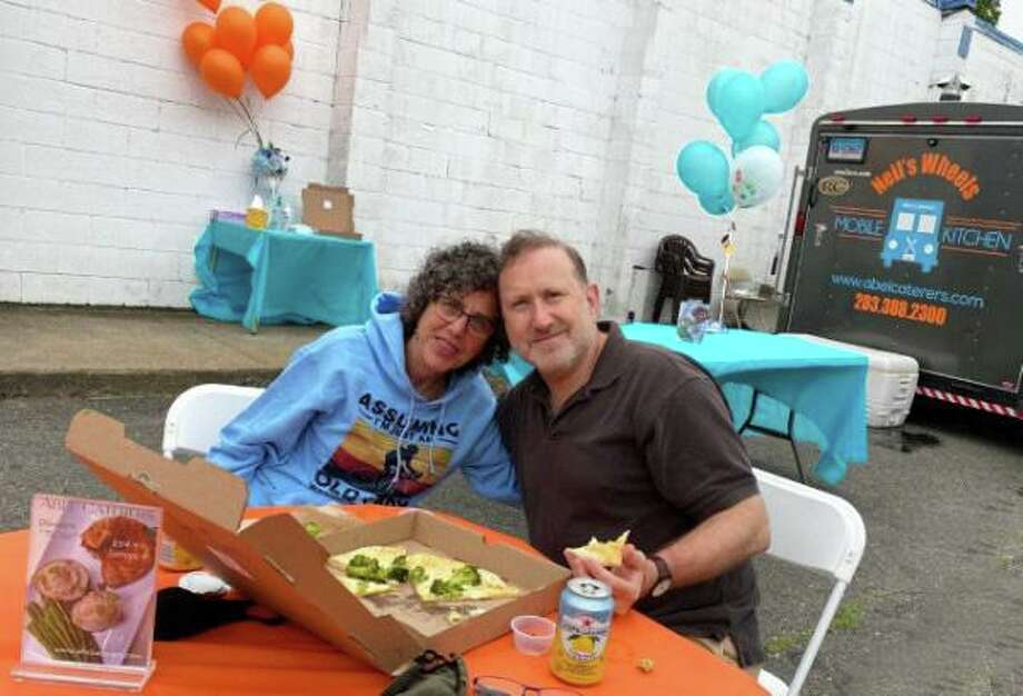 Rabbi Rona Shapiro of B'nai Jacob and David Franklin enjoying some food from Neil's Wheels. Photo: Melissa Rosado / Contributed Photo