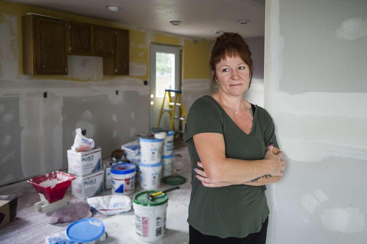 Rebecca Johnson poses for a portrait inside her home in downtown Sanford Thursday, Sept. 24. (Katy Kildee/kkildee@mdn.net)
