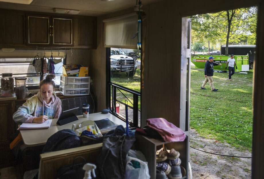Autumn Pontseele, 18, works on schoolwork virtually inside the camper she and her mom are living in on their property, as construction workers continue renovating their home Friday, Sept. 25 in downtown Sanford. (Katy Kildee/kkildee@mdn.net) Photo: (Katy Kildee/kkildee@mdn.net)