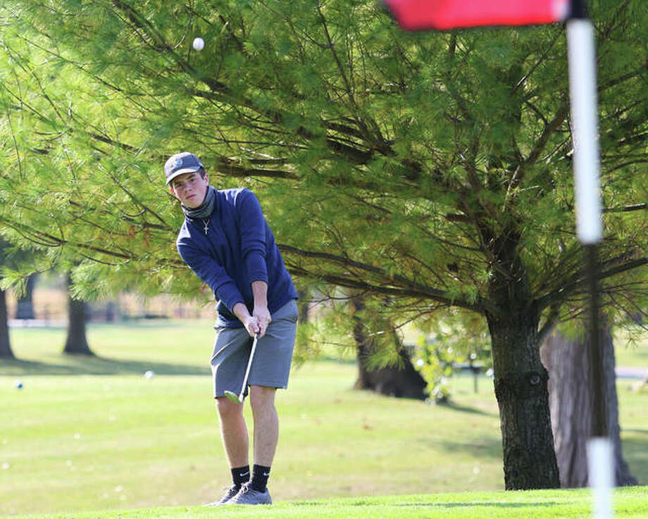 CM's Jake Cheatham chips onto the green at hole No. 1 at Belk Park golf course in Wood River during Tuesday's Class 2A Regional boys golf tournament. Photo: Greg Shashack / The Telegraph