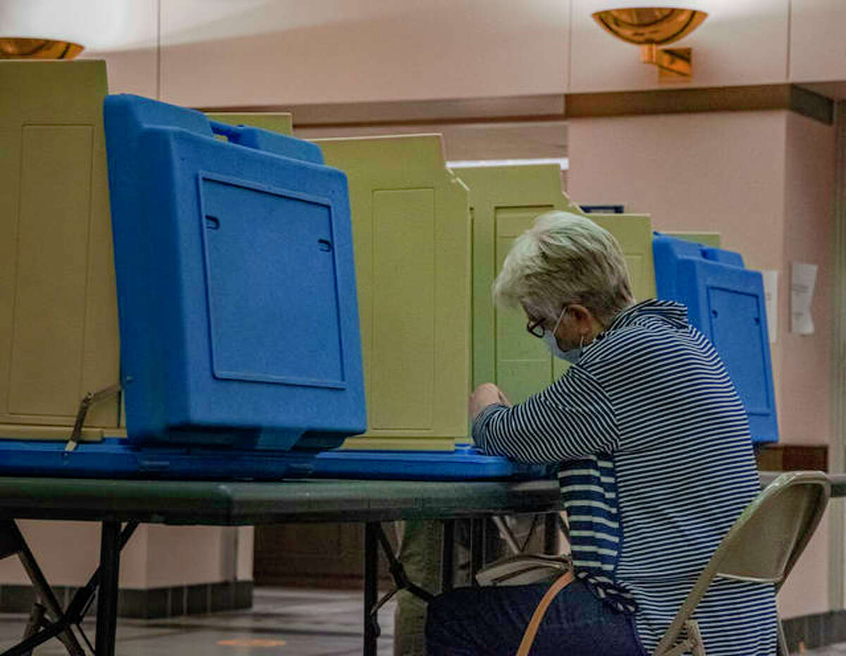 A Madison County resident fills out her ballot during an early voting day on Tuesday in the Madison County Administration Building in Edwardsville.