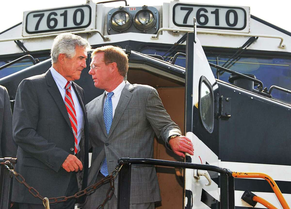 The late Senate Majority Leader Joseph Bruno, left and David Fink, president of Pan Am Railways aboard a locomotive following a news conference announcing the construction of an new rail terminal in Mechanicville Tuesday morning July 8, 2008. (John Carl D'Annibale/Times Union)
