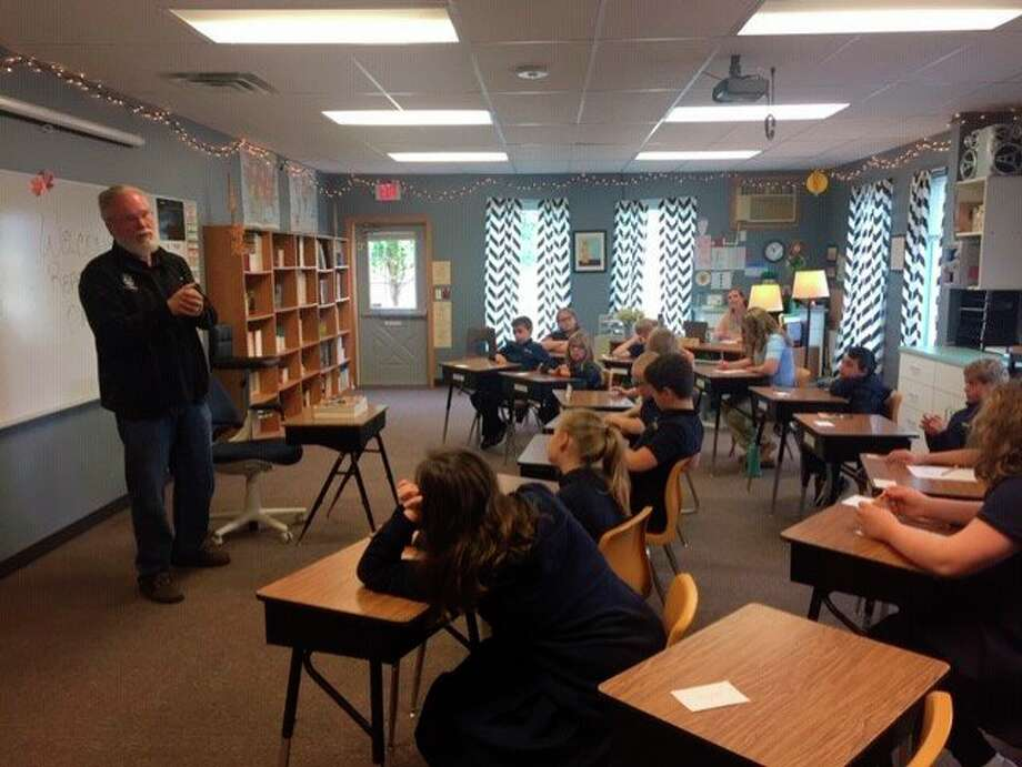 Rep. Jack O'Malley talks to students at New Covenant Christian Academy about what a state representative does and the the different branches of government. (Courtesy Photo)