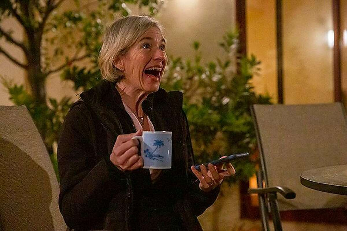 Jennifer Doudna reacts to winning the Nobel Prize while meeting with reporters Wednesday at her Berkeley home.