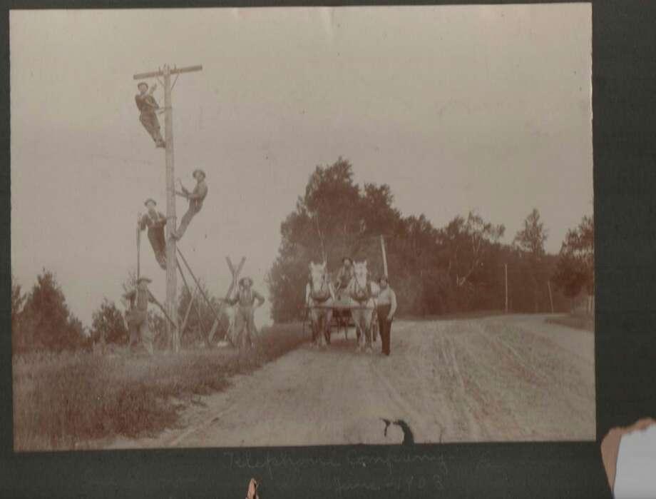 Crew from telephone company installing phone lines near Bear Lake in 1903.(Courtesy Photo)