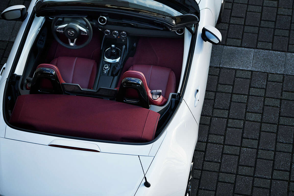 The centennial edition MX-5s are equipped with red leather seats.