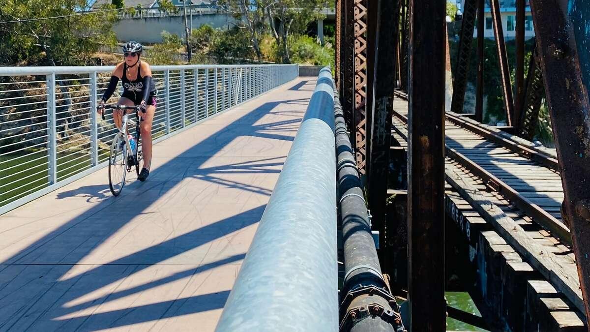 A cyclist crosses the San Lorenzo Bridge in Santa Cruz on the Coastal Rail Trail.