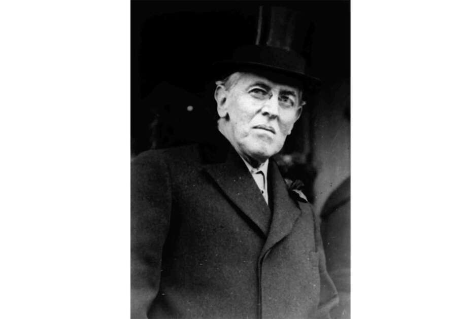 FILE - This 1924 file photo shows Woodrow Wilson. Wilson was at talks in Paris on ending World War I when he fell ill in April 1919. His symptoms were so severe and surfaced so suddenly that his personal physician, Cary Grayson, thought he had been poisoned. After a fitful night caring for Wilson, Grayson wrote a letter back to Washington to inform the White House that the president was very sick. (AP Photo, File) Photo: Associated Press / ap