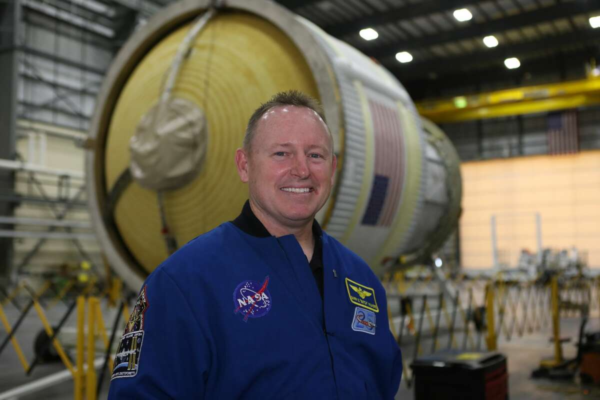 """NASA astronaut Barry """"Butch"""" Wilmore will serve as commander of Boeing's CST-100 Starliner spacecraft during its first crewed flight. He replaces Boeing astronaut Chris Ferguson, who decided not to fly for personal reasons. Wilmore is pictured inside the United Launch Alliance Horizontal Integration Facility at Cape Canaveral Air Force Station in Florida in 2017, when he viewed the first integrated piece of flight hardware for NASA's Space Launch Systemrocket."""