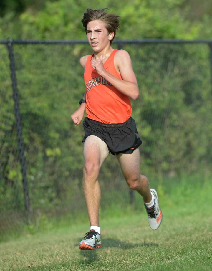 Matthew McDonough (shown in a meet last fall) was among the scoring runners as the Ridgefield boys cross country team defeated Staples on Tuesday. Photo: H John Voorhees III / Hearst Connecticut Media / The News-Times
