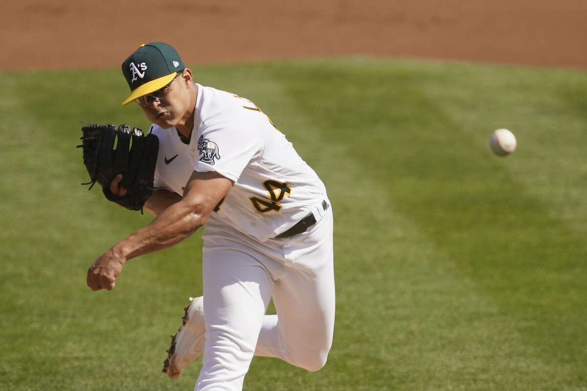 Oakland Athletics pitcher Jesus Luzardo throws against the Chicago White Sox during the first inning of Game 1 of an American League wild-card baseball series Tuesday, Sept. 29, 2020, in Oakland, Calif. (AP Photo/Eric Risberg)