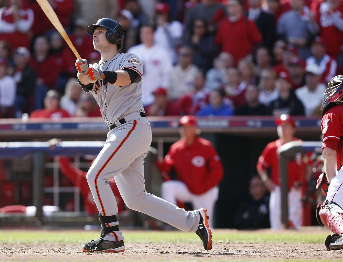 San Francisco Giants' Buster Posey hits a grand slam against the Cincinnati Reds in the fifth inning of Game 5 of the National League division baseball series, Thursday, Oct. 11, 2012, in Cincinnati. (AP Photo/David Kohl)