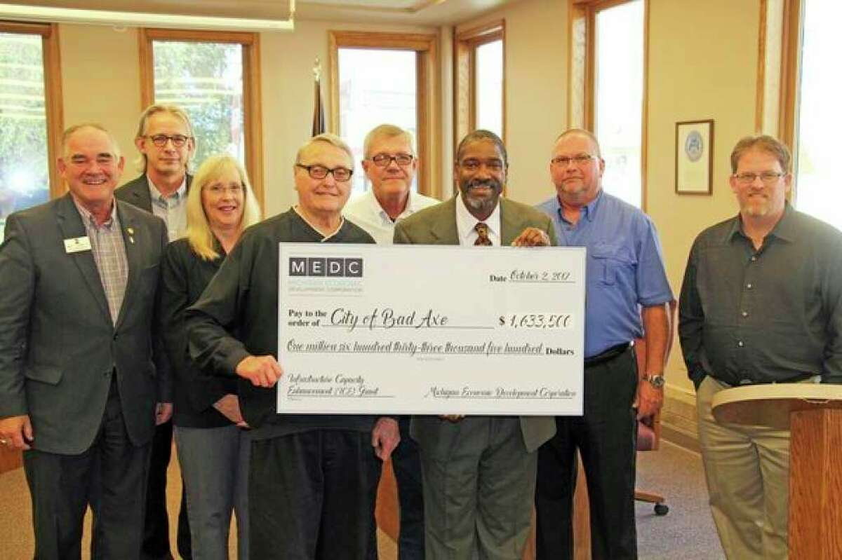 Dale VanDeVusse, center, with other Bad Axe officials accepting an infrastructure improvement grant in 2017. VanDeVusse announced his intention to retire from the Bad Axe City Manager role this week. (Tribune File Photo)