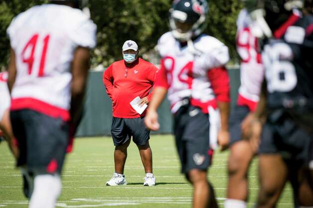 Houston Texans interim head coach Romeo Crennel watches his players warm up during his first practice leading the team Wednesday, Oct. 7, 2020, at The Houston Methodist Training Center in Houston. Crennel takes over for fired Houston head coach Bill O'Brien, who was fired this week after an 0-4 start. Photo: Brett Coomer, Staff Photographer / © 2020 Houston Chronicle