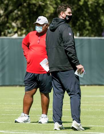 Houston Texans interim head coach Romeo Crennel, left, stands with offensive coordinator Tim Kelly as he watches his players warm up during his first practice leading the team Wednesday, Oct. 7, 2020, at The Houston Methodist Training Center in Houston. Crennel takes over for fired Houston head coach Bill O'Brien, who was fired this week after an 0-4 start. Photo: Brett Coomer, Staff Photographer / © 2020 Houston Chronicle