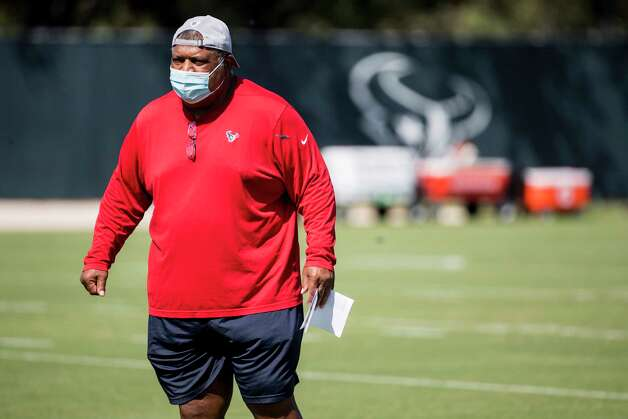 Houston Texans interim head coach Romeo Crennel watches his players warm up during his first practice leading the team Wednesday, Oct. 7, 2020, at The Houston Methodist Training Center in Houston. Crennel takes over for fired Houston head coach Bill O'Brien, who was fired this week after an 0-4 start to the 2020 season. Photo: Brett Coomer, Staff Photographer / © 2020 Houston Chronicle