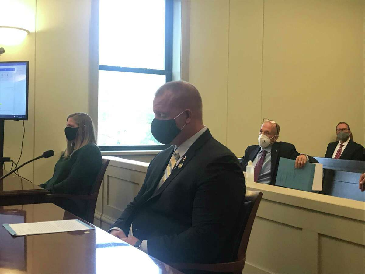 From left, Columbia County Deputy Kelly Rosenstrach and her husband Alex Rosenstrach, foreground, are arraigned in Columbia County Court in Hudson, NY, Wednesday Oct. 8, 2020 for second-degree gang assault and other charges.