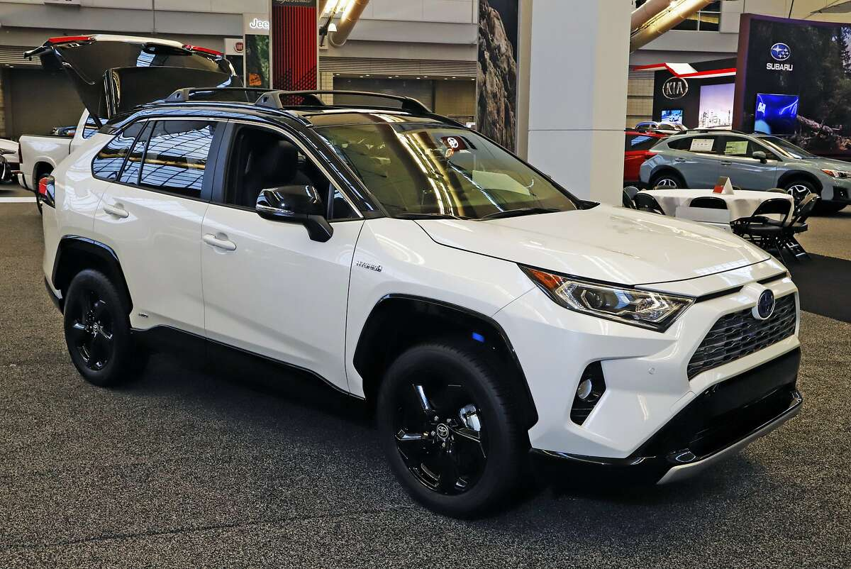 FILE - This Feb. 13, 2020 photo shows a 2020 Toyota RAV4 Hybrid on display at the 2020 Pittsburgh International Auto Show in Pittsburgh.