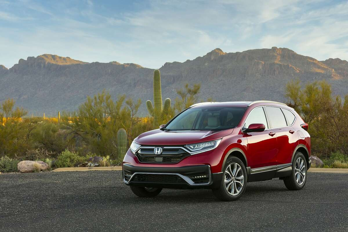 This photo provided by Honda shows the 2020 Honda CR-V Hybrid. The Honda CR-V Hybrid and Toyota RAV4 Hybrid are similar in fuel economy, power and practicality according to Edmunds. Each is a smart buy for a fuel-efficient SUV. (Wes Allison/Honda via AP)