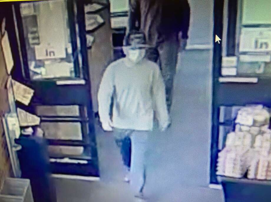 Shelton police are seeking the public's assistance in identifying the individual suspected in four robberies - one Monday afternoon at the Stop & Shop in Shelton - throughout Fairfield County in the last week. The photo above is from the Stop & Shop surveillance cameras. Photo: Shelton Police Department / Contributed Photo / Connecticut Post